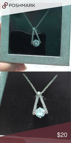 No brand never worn necklace Silver pendant with triangle and fake diamond. Not real. Really cute unique design. Comes with box. Gave as present Jewelry Necklaces