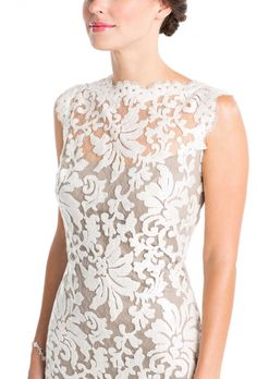An ivory and grey lace dress that's perfect as a casual, short wedding dress or a bridesmaid dress. Affordable bridal rentals and dresses at Vow To Be Chic.