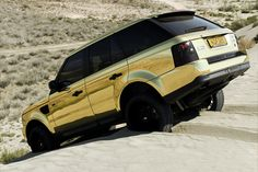 fuckyeahthebetterlife: I couldn't find a proper caption for a chrome gold Range Rover in the desert.