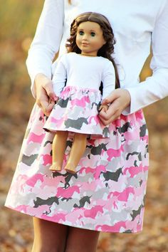 Fits American Girl dolls and other 18 inch dolls | Handmade with care { Matching Girl and Doll Unicorn Herd Skirts in Pink } Features: --- made from designer fabric --- elastic waists --- girl's skirt available in sizes 1T, 2T, 3T, 4T, 5T, 6, 7, 8, 10, 12, 14 (see 5th photo for size chart) --- doll skirt fits American Girl, Bitty Baby, and other dolls with similarly sized waists This item is made to order especially for you. My current turnaround time is displayed on the Shippin...