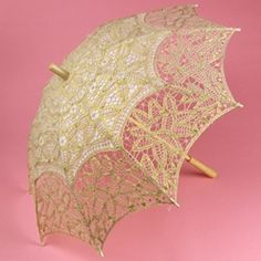This beautiful gold parasol is a lightweight, elegant sunshade made from Battenburg Lace. Used for weddings, photography, theatrical performances and garden parties. It features intricate embroidery throughout.