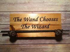 Wand display.  https://www.etsy.com/listing/273566454/premium-harry-potter-wand-display-w-owl