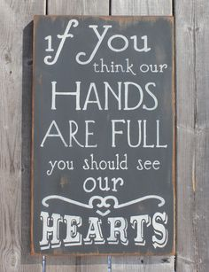 If you think our hands are full you should see our hearts. Sign made by The Primitive Shed, St. Catharines