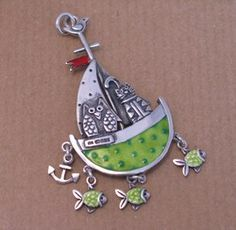 """This is an impressive piece of jewellery design, its craftsmanship is reminiscent of the renaissance designs of the 16th century but with a contemporary twist!.    Heavyweight silver with a vibrant green enamel boat that even has little dark green """"peas"""" on it and a red enamel flag at the top. The boat even has a hallmark"""