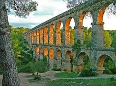 Les Ferreres Aqueduct, Catalonia, Spain - (also known as Pont del Diable meaning Devil's Bridge) was built to take water from the Francoli water 15 kilometers (9 miles) south to the city of Tarragona. It probably dates from the time of Augustus, the first ruler of the Roman Empire. The aqueduct has a maximum height of 27 meter and a length of 249 meter. It was composed by 25 upper arches and 11 lower arches.
