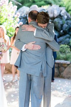 Brides Father Hugging Groom   The-Palms-Chico-California-Wedding-Photographer