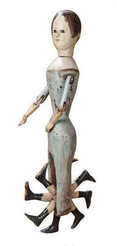 """This wooden doll made in the 19th century can """"walk."""" The wheel of legs turns if the doll is pushed across the floor. This doll, 20 inches t..."""