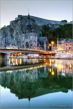DINANT, BELGIUM is sandwiched between the Meuse River and its citadel, originally built in 1051. You can spend a day visiting the waterfalls of the Grotto of Dinant or the Sanctuary of Beauraing, then grab a table at one of the local café while taking in the views of the sparkling Meuse River.