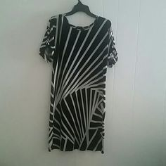 Beautiful fitted dress Black & Tan printed dress Forever Dresses High Low