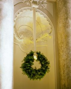 Wreaths of New England double-faced evergreens hang in the wall's nooks at this reception