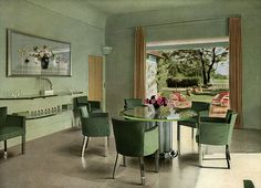1938 In a French dining room, chrome and glass reflect the soft green walls and furnishings for a serene look. Verde Vintage, Art Deco, Elegant Dining Room, Vintage Interiors, Deco Interiors, Home Look, Room Set, Vintage Decor, 1930s Decor