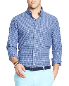 Made from crisp cotton poplin, this trim-fitting checked shirt from Polo Ralph Lauren is ideal for the office or catching the game with friends. Pair it with colored denim shorts for an endlessly vers