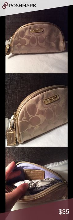Authentic Coach Logo Makeup Pouch Brand new, never used gold logo Coach makeup bag. Comes from a smoke free home! Very chic and compact. Coach Bags Cosmetic Bags & Cases