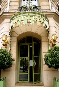 Celadon green façade at the Champs-Élysées branch of Ladurée