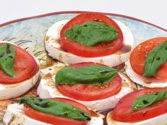 YUMMY!!!  Tomato, mozzarella and basil with olive oil and balsamic vinegar, salt and pepper.  Awesome for a dinner party appetizer.