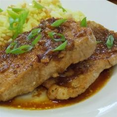 A sweet and savory plum sauce, flavored with ginger and cloves, highlights the flavor of pan-braised pork chops for an easy summertime dinner. Braised Pork Chops, Grilled Pork Loin, Pork Loin Chops, Pork Ham, Pork Chop Recipes, Meat Recipes, Crockpot Recipes, Cooking Recipes, Chicken Recipes
