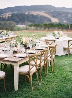 Mixed dining table inspiration (wood farm tables with rounds covered in off white/beige tablecloths)