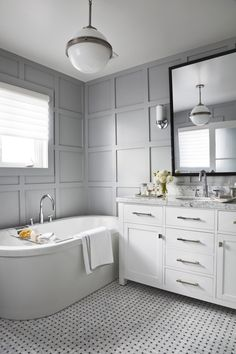 Love the grey walls and wainscoting. One day I will paint our cabinetry white.