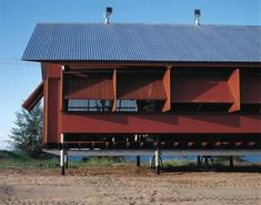 Hinged shutters in Marika-Alderton by Glenn Murcutt [060] | filt3rs Glen Murcutt, Alvar Aalto, Building Exterior, Shutters, Design Elements, Arched Cabin, Building Sketch, Black House, Metal Roof