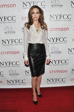 Elegant Angelina Jolie wearing silk blouse and leather skirt at 2011 New York Film Critics Circle awards. #angelinajolie