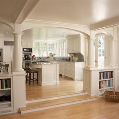 Like the idea of built-in shelves between kitchen and family room -- i can do this! White kitchen and breakfast room with fireplace and arches - traditional - kitchen - new york - by Huestis Tucker Architects, LLC House Design, House, Sunken Living Room, Home, Living Room And Kitchen Design, Breakfast Room, New Homes, Home Kitchens, Minimalist Kitchen