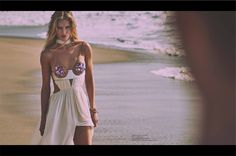 Rosie hits the beach in a Tom Ford dress with a bra top