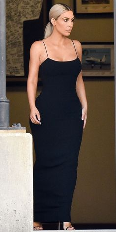 During Serena Williams's wedding, Kim Kardashian showed us how less is always more in a chic black dress paired with elegant, strappy heels.