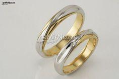 http://www.lemienozze.it/operatori-matrimonio/gioielli/biffi_gioielli/media/foto/7  Fedi nuziali bicolore in oro bianco e giallo.