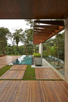 Green vegetation and pool Modern Breezy Residence Encompassed by Lush Vegetation in Brazil