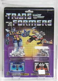 """Frenzy and Laserbeak, two Decepticon microcassette tapes, still on the blister card. From the first-generation """"Transformers"""" line of toys"""