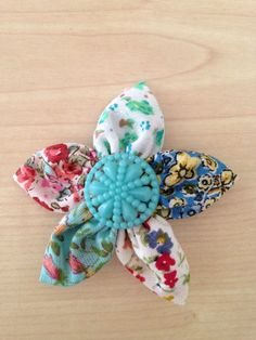 A personal favourite from my Etsy shop https://www.etsy.com/uk/listing/471511931/shabby-chic-flower-brooch-vintage