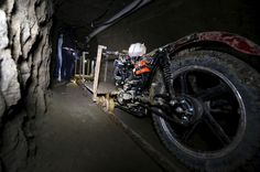 """A motorcycle modified to run on rails sits inside a tunnel connected to the Altiplano Federal Penitentiary that was used by drug lord Joaquin """"El Chapo"""" Guzman to escape in Almoloya de Juarez, on the outskirts of Mexico City, on July 15, 2015. U.S. law enforcement officials met with agents of the Mexican attorney general's office this week to share information related to Guzman's escape from prison."""