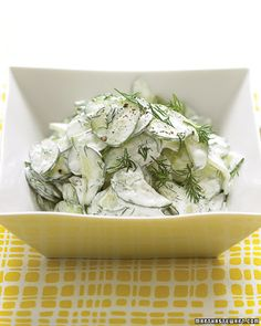 healthy lunch: cucumber salad with sour cream and dill dressing