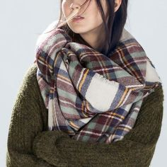 There's nothing more soothing than to be wrapped in warmth on a cold day, and this multicolour plaid square shawl scarf ought to do the trick. This non-stretchable piece comes with frayed edges as well for added style. Whenever you wanna keep away from chill and stay stylish, just wrap yourself up in this comfy beauty.