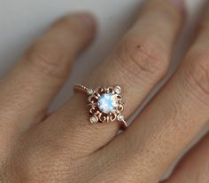 Beautiful vintage inspired moonstone and diamond ring. Available in 14 and 18k gold, platinum. Other stones are also available: morganite, pearl, turquoise, diamond, rose cut diamond, black diamond, aquamarine and many more. Please contact us for the pricing info. Click here for moissanite ring: https://www.etsy.com/listing/475034416/vintage-moissanite-ring-gold-engagement?ref=shop_home_active_3 Please choose ring size and metal at the drop down menu. Larger sizes than 8 available upon…