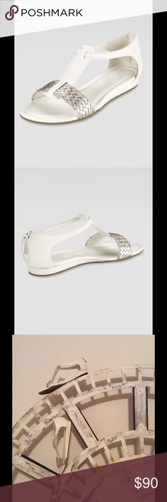 🆕 Cole Haan ivory & silver flat sandals Purchased at Neiman Marcus. Elegant Jaycee Flat Sandal in ivory and silver (white gold). Features nearly flat wedge and heel zippers. Size 9.5B. Leather upper, rubber sole. Brand new (never worn, only tried on once with socks). Sold with box and original packaging. Sold out online. Cole Haan Shoes Sandals