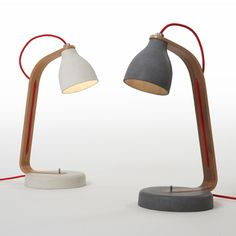 Heavy Desk Light by Benjamin Hubert for Decode: These lamps have a cast-concrete base and shade, joined by a wooden stand through which a red flex is threaded.