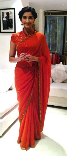 Love this outfit! Sonam Kapoor in a red saree with collar blouse