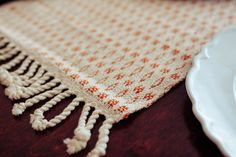 Washable cotton table runners need twisted fringe to prevent fraying when washed. Farmhouse Table Runners, Modern Farmhouse Table, Dog Bowl Mat, Cotton Decor, Dining Room Table Decor, Thanksgiving Table Settings, Fall Table, Rug Sale, Gifts For Pet Lovers
