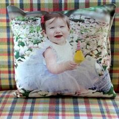 Print a photo onto fabric and make into a pillow.