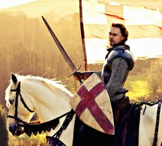 You know what I love?  Tom Hiddleston. In armour. And a sword. On a horse. A white horse.  Yup.