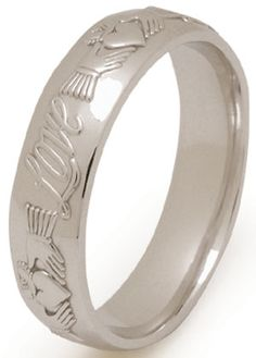Claddagh Wedding Ring. Features the words 'Love, Loyalty and Friendship' on the band of the ring