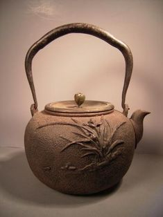 Meji Period iron pot with orchid design