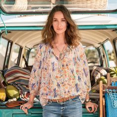"""CHARLESE BLOUSE--A Sundance classic interpreted in a dreamy, watercolor-like floral print. Flowing silk crinkle chiffon with a smocked neckline, elasticized three-quarter sleeves and shell buttons. Dry clean. Imported. Exclusive. Sizes  XS (2), S (4 to 6), M (8 to 10), L (12 to 14), XL (16). Approx. 26""""L."""