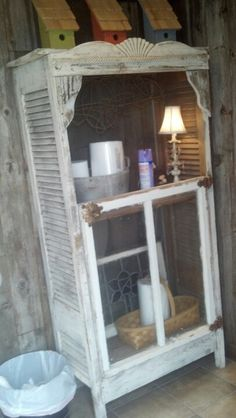 Cool bathroom cabinet!  Made from old shutter doors, an old window, and decorative accents....this is going to be in my bathroom very soon!