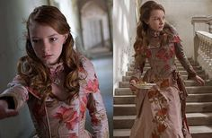 The Secret of Moonacre - Dakota Blue Richards as Maria Merryweather, wearing an antique rose taffeta dress with floral embroideries.