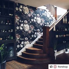 I've been admiring this beautiful use of #elliecashmandesign Dark Floral II Black Saturated #floralwallpaper by Alex and Quinn at @flwrshop in Nashville for some time now. Also feeling inspired by their personal stories and how this shop came to be! Just a lovely space with dramatic daylight and that gorgeous wooden staircase! Well done