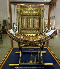 Inlaid Tutanhkamun throne with concave seat bottom, tresses, and X-Legs