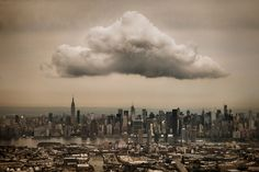 """Midtown Cloud    """"I snapped this from the window seat as my plane was approaching LaGuardia Airport. The cloud is over Manhattan, while Brooklyn and Queens are visibile in the foreground, separated by Newtown Creek.""""    Captured by Jeff Weston"""
