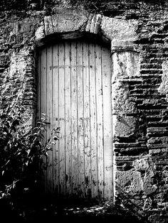 Auvillar, France.  Weathered door.  Port d'Esplande.  2006.